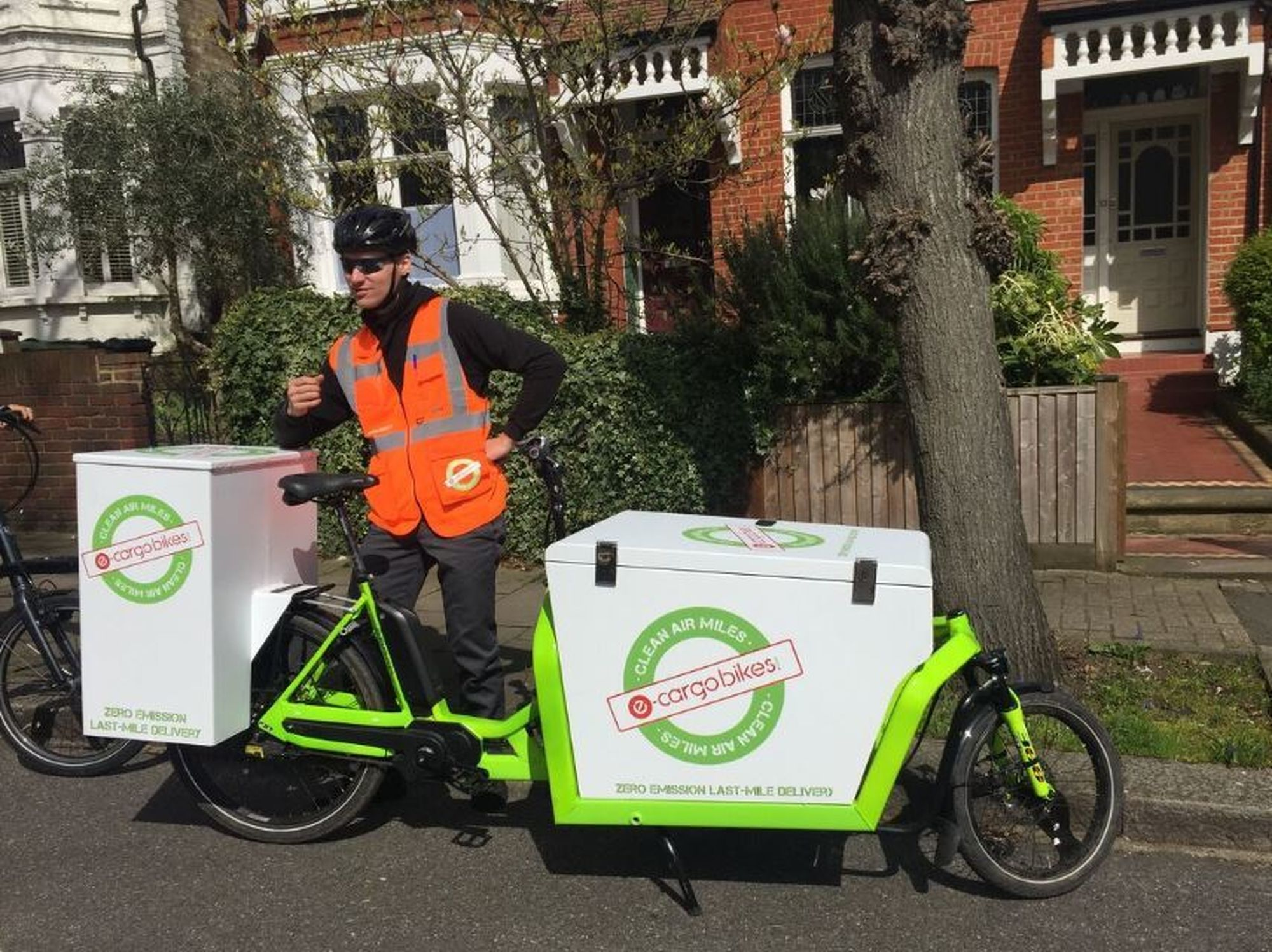 E-cargobikes.com Rider stands with e-cargo bicycle